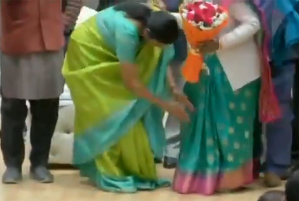 Minister Nirmala Sitharaman felicitates and touches feet of mothers of martyrs