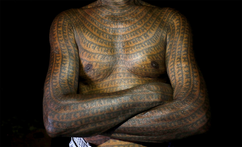 The intricately tattooed bodies and faces of low caste Ramnami Samaj Hindus